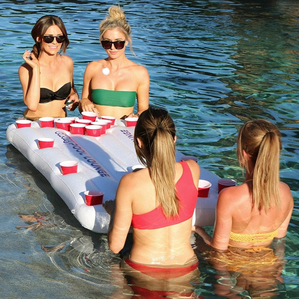 this inflatable beer pong table is the perfect summer pool party accessory that lets you play anywhere