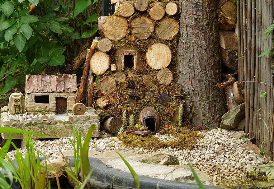 Photographer Builds A Tiny Village For A Mouse He Found In His Yard