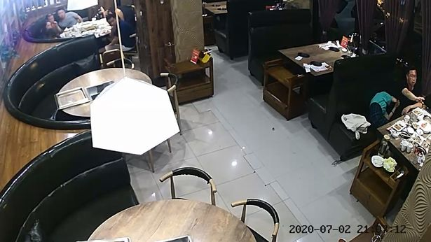 husband knocks out cheating wife in one slap in front of lovers in a restaurant