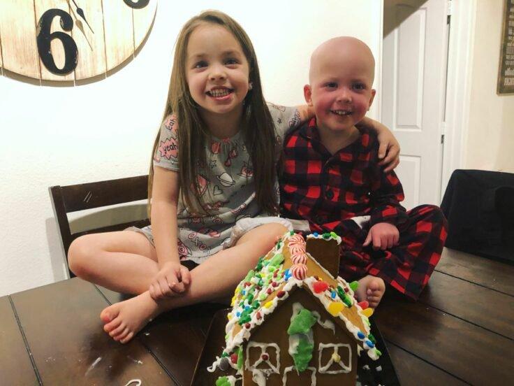 sister comforts sick brother battling leukaemia in heartbreaking photo