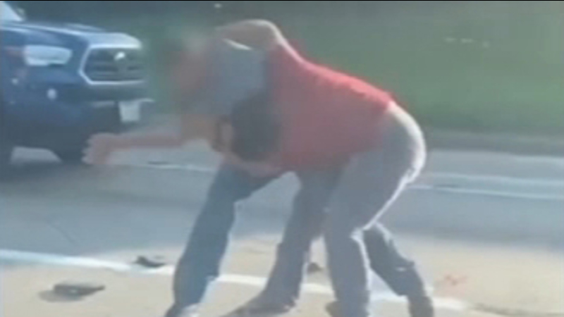 vicious road rage fight between a man and woman after she 'cut him off' in traffic