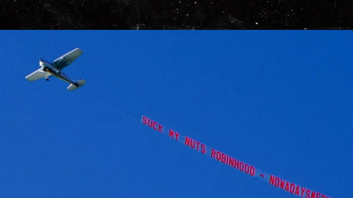plane flies over robinhood hq with 'suck my nuts' banner