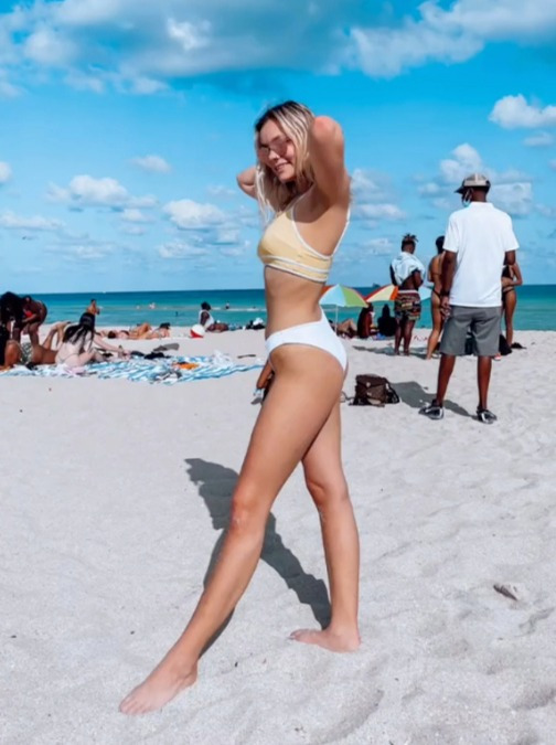 Woman Shares Hilarious X-rated Optical Illusion In Beach Snap