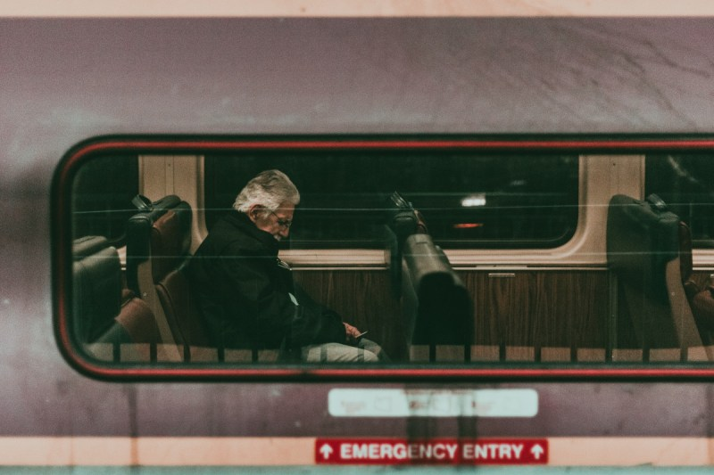 Man asleep on train