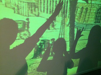 Taking shadow pictures in the Story of Berlin exhibit