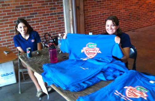 A former student of mine distributes Gator T-shirts to students who are season ticket holders.
