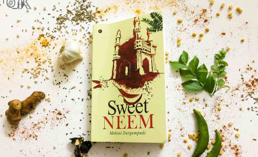 Sweet Neem book on the background of different spices