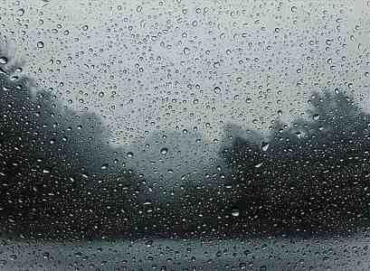 droplets of rain on a glass window.