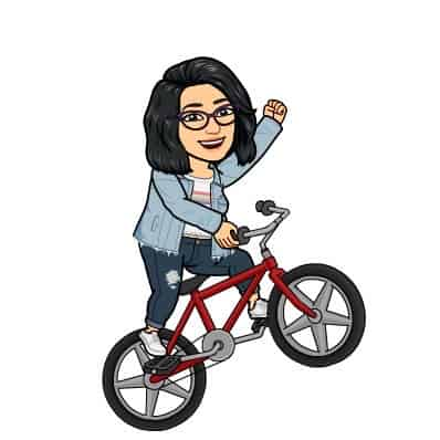 Anime representation of Keerthi riding a bicycle.