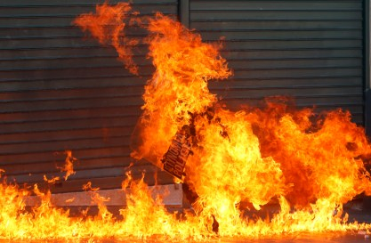 A riot policeman is engulfed by flames after a protester threw petrol bombs in Athens' Syntagma square during a 24-hour labour strike