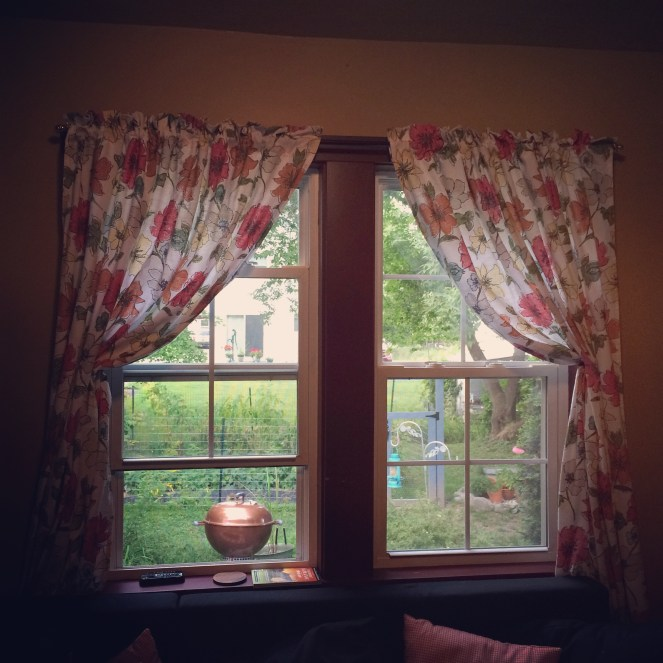 I bought two table cloths at Target on clearance and made them into curtains, I made a pocket for the curtain rod and that was it, they were already hemmed.