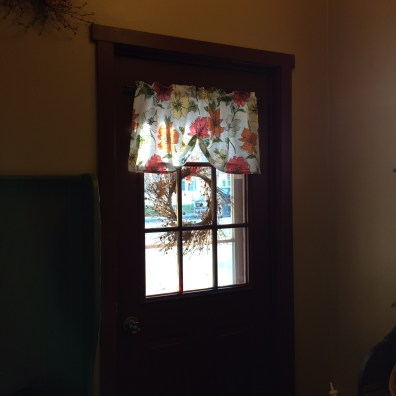 I used some of the cut off fabric to make a small valance for the door that's in the room.