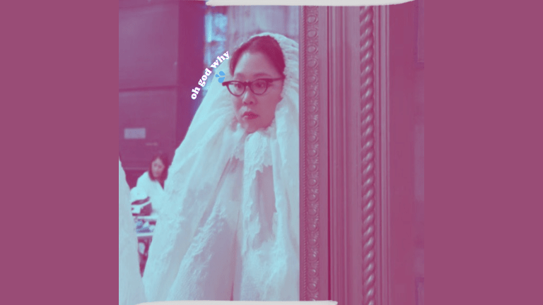 Minju Kim, a South Korean fashion designer, looks at her reflection in despair. She's clutching a length of fabric in her hand.