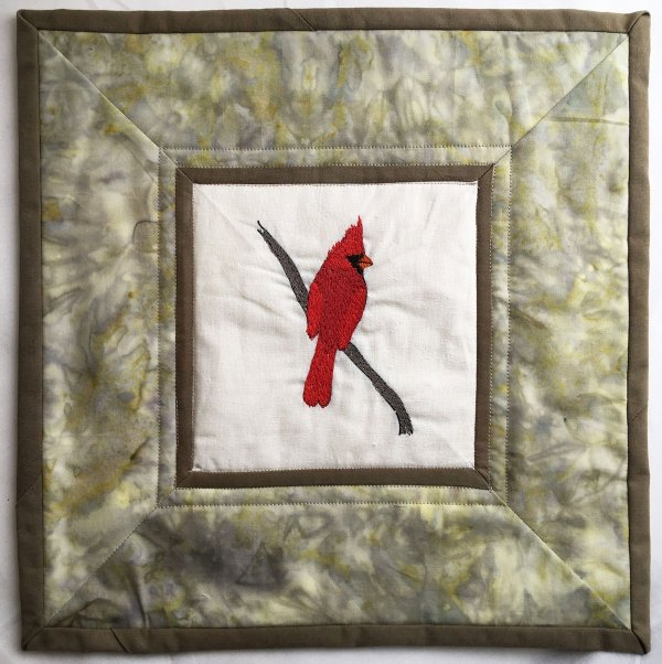 Small quilt with thread painted cardinal