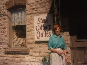 Kathy in front of Stone Cottage Quilts