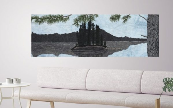 Thread painting of a Island and lake scene set in a living room with a white couch