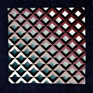 quilted wall hanging with 3 dimensional design