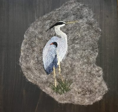 great blue heron in thread painting on felt and pine board