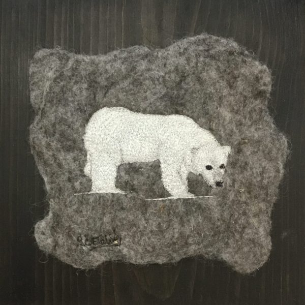 Polar bear embroidered on felted art mounted on pine board