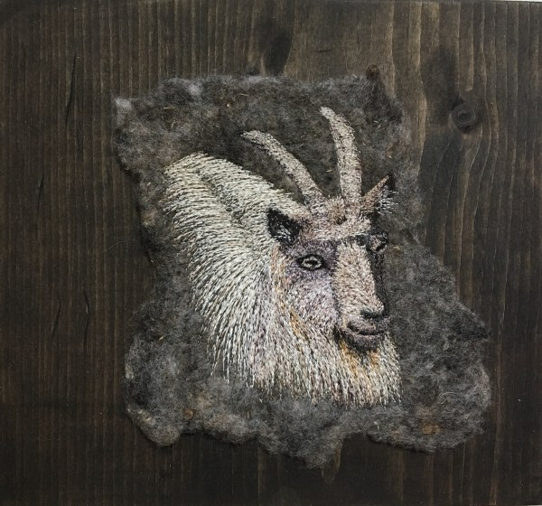 Hand felted fabric with thread painted goat by bridget o'flaherty Mounted on pin