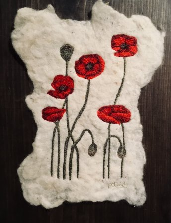 Thread Painted red poppies on hand made felt mounted on a Pine board