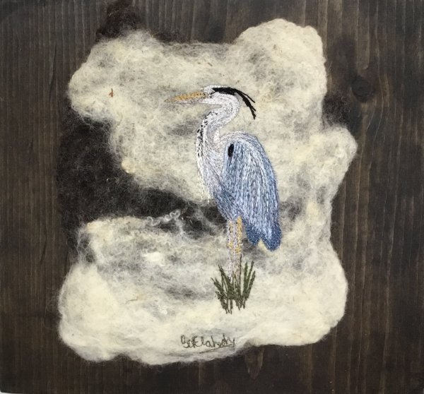 Free motion embroidery of a Heron on felted art.