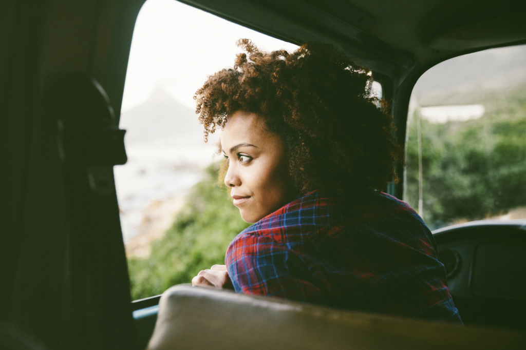 Girl is looking out of the car window