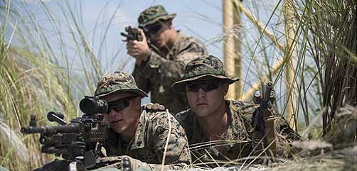 U.S. Marines sight in during platoon movement at Crow Valley, Philippines - ALLOW IMAGES