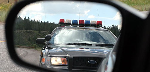 Police Car in Side View Mirror - ALLOW IMAGES