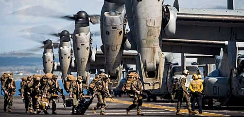 U.S. Marines load into MV-22 aircraft - ALLOW IMAGES