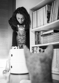 woman looking at cat