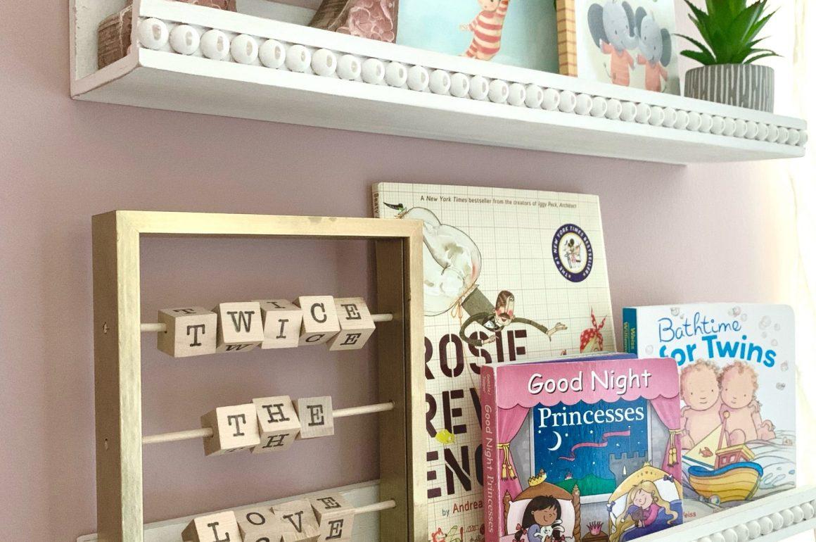 bookshelves in nursery with DIY decor