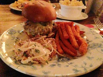 The classic 6oz burger with sweet potato fries and coleslaw