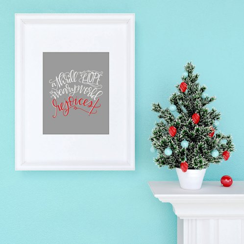 Christmas Tree Decoration with empty frame on aqua background
