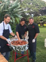 Chefs/Co-Owners Jaron, Travis and Cody, manning the paella at a catering event.