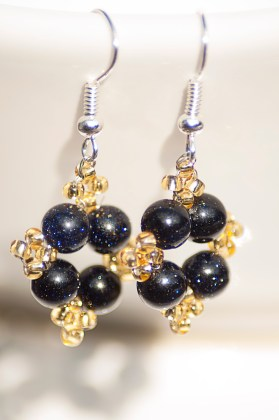 Stunning blue goldstone earrings, accented with complementary golden seed-beads.