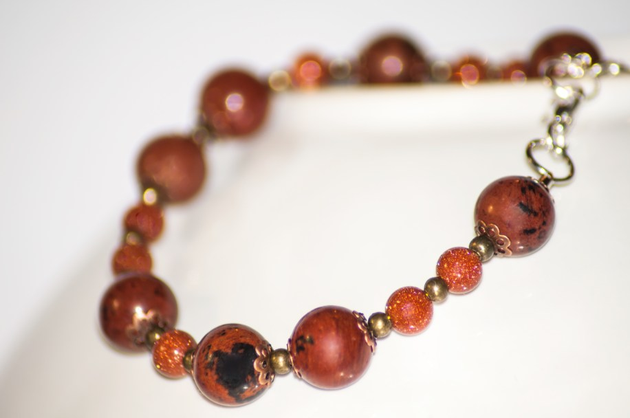 Elegant and visually stunning bracelet with mahogany obsidian and goldstone beads