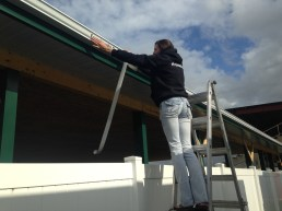 applying sticker to eavestrough gutter swan river manitoba