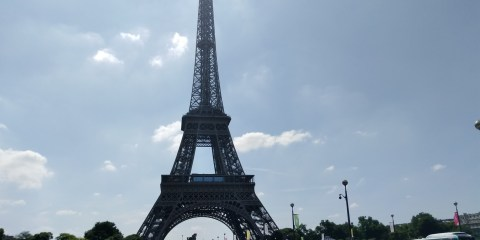 The Eiffel Tower on a very busy tourist day in Paris where it is too sunny