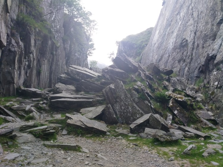 A pile of rocks, just barely a path through a rocky valley in Wales