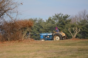Homeowner along Rt 144 near fairgrounds clearing downed branches with his Ford tractor. Photo by Mike Hartley