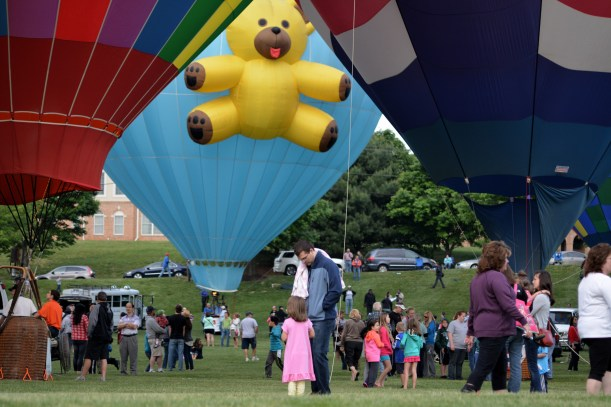 Do you think the young lady in the pink dress is asking her Dad for a teddy bear? Photo by Mike Hartley