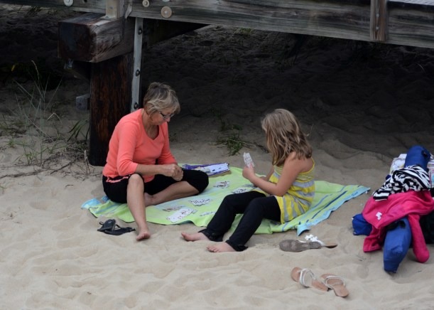 Card game behind the boardwalk. Someone get the Police. Photo by Mike Hartley