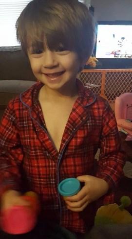 blonde toddler holding playdoh