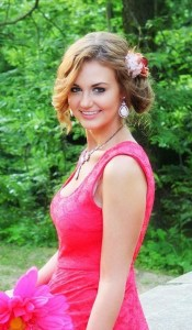 blonde girl in pink dress with flower in her hair