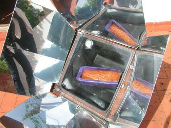 Solar power cake in a solar oven sun energy solar power powered cooking