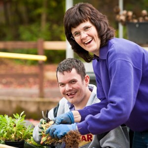 A volunteer and client enjoying the health benefits of gardening at the charity Thrive
