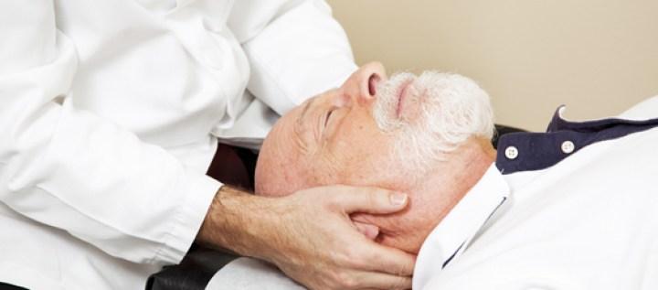 A doctor adjusting a patient's neck.