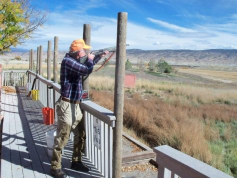 A upland game bird hunter shoots some wobble trap at Black Canyon wing and Clay in Delta, Colorado. Trap shooting is a great way to practice your shotgunning skills for upland birds