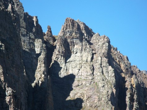 A photo of some of the typical terrain and steep jagged cliffs found in the maroon bells-snowmass wilderness area of colorado, taken while on a mountain goat hunt. With trophy goat at top of peak